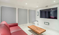 BNPS.co.uk (01202 558833)<br /> Pic: Strutt&Parker/BNPS<br /> <br /> Cinema room..<br /> <br /> A former WW2 battery, with unrivalled views across the channel to France, has come on the market - but you'll need deep pockets to shell out on its stunning location.<br /> <br /> The cliff top gun emplacement was rapidly constructed in 1940, as Britsh troops were fleeing Dunkirk, and has now been transformed into a £6million 'James Bond style' property.<br /> <br /> The Gunnery, near Kingsdown in Kent offers 'incredible' views of the Channel, with the iconic White Cliffs of Dover visible to the west, and France to the south, while also coming with six acres of sandy beach.<br /> <br /> The unique 82ft long property is accessed by an underground tunnel that leads through the cliff to a glass lift which travels up to it. Another secret tunnel inside the four bedroom home, which is just a few feet from the cliff edge, provides passage to a home cinema.<br /> <br /> The 50ft long living room has floor to ceiling windows and the original gun loops can still be seen.