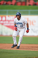 Lake County Captains catcher Jonathan Laureano (23) leads off first base during the first game of a doubleheader against the South Bend Cubs on May 16, 2018 at Classic Park in Eastlake, Ohio.  South Bend defeated Lake County 6-4 in twelve innings.  (Mike Janes/Four Seam Images)