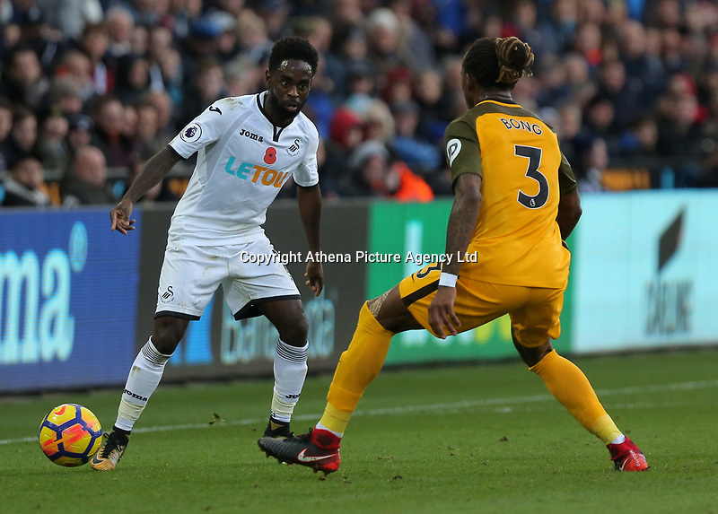 (L-R) Nathan Dyer of Swansea City stands against Gaetan Bong of Brighton during the Premier League match between Swansea City and Brighton and Hove Albion at The Liberty Stadium, Swansea, Wales, UK. Saturday 04 November 2017
