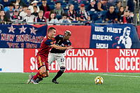 FOXBOROUGH, MA - SEPTEMBER 21: Brooks Lennon #12 of Real Salt Lake dribbles as Luis Caicedo #27 of New England Revolution defends during a game between Real Salt Lake and New England Revolution at Gillette Stadium on September 21, 2019 in Foxborough, Massachusetts.