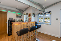 BNPS.co.uk (01202 558833)<br /> Pic: Savills/BNPS<br /> <br /> Pictured: The bar.<br /> <br /> A former tidal mill next to an impressive viaduct that looks like the perfect backdrop for a children's book is on the market for £3.5m.<br /> <br /> The Old Mill is over 600 years old and would be an ideal home for Swallows and Amazons or The Railway Children-inspired adventures.<br /> <br /> The impressive Grade II listed six-bedroom house has its own private harbour and panoramic views of the much-photographed Forder Railway Viaduct.<br /> <br /> It is only the second time the property in Cornwall has been on the market since 1886 and agents Savills say it is a once in a lifetime opportunity.