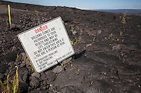 Danger sign in lava field at Hawai'i Volcanoes National Park, Kalapana, Big Island.