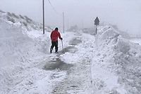 WEATHER PICTURE WALES<br /> Pictured: A man walks in the heavy snow in the village of Trfil, south Wales, UK.<br /> Re: Beast from the East and Storm Emma has been affecting most parts of the UK.