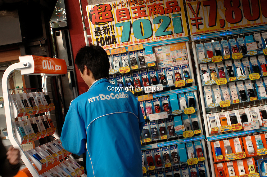 Mobile phones are for sale by NTT DoCoMo and AU KDDI in Tokyo, Japan..