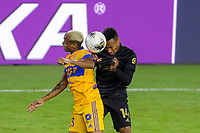22nd December 2020, Orlando, Florida, USA;  LAFC Mark Anthony Kaye challenges for a header during the Concacaf Championship between LAFC and Tigres UANL on December 22, 2020, at Exploria Stadium in Orlando, FL.