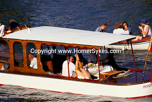 'HENLEY ROYAL REGATTA', A LAZY AFTERNOON ON THE RIVER ENJOYING THE ROWING COMPETITION OR JUST MESSING AROUND.GIRL MOONING.