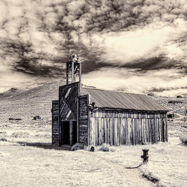 Black and white infrared image of old wooden firehouse in Bodie California