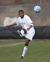University of Connecticut defender Sergio Campbell (4) clears the ball. .NCAA Tournament. Creighton University (blue) defeated University of Connecticut (white), 1-0, at Morrone Stadium at University of Connecticut on December 2, 2012.