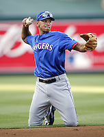 Alex Rodriguez of the Texas Rangers takes ground ball's from his knee's before a 2002 MLB season game against the Los Angeles Angels at Angel Stadium, in Los Angeles, California. (Larry Goren/Four Seam Images)