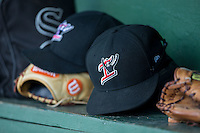 A Kannapolis Intimidators cap sits on the top of the bench in the home dugout during the game against the Lakewood BlueClaws at Kannapolis Intimidators Stadium on May 8, 2016 in Kannapolis, North Carolina.  The Intimidators defeated the BlueClaws 3-2.  (Brian Westerholt/Four Seam Images)