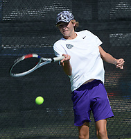Fayetteville's Jacob Nordin returns a shot Tuesday, Oct. 12, 2021, during the 6A state tennis finals at Memorial Park in Bentonville. Visit nwaonline.com/211013Daily/ for today's photo gallery.<br /> (NWA Democrat-Gazette/Andy Shupe)