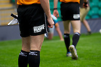 20130802 Copyright onEdition 2013 ©<br />Free for editorial use image, please credit: onEdition.<br /><br />Detail of the JP Morgan branding on the assistant referee's shorts during the J.P. Morgan Asset Management Premiership Rugby 7s Series.<br /><br />The J.P. Morgan Asset Management Premiership Rugby 7s Series kicks off for the fourth season on Thursday 1st August with Pool A at Kingsholm, Gloucester with Pool B being played at Franklin's Gardens, Northampton on Friday 2nd August, Pool C at Allianz Park, Saracens home ground, on Saturday 3rd August and the Final being played at The Recreation Ground, Bath on Friday 9th August. The innovative tournament, which involves all 12 Premiership Rugby clubs, offers a fantastic platform for some of the country's finest young athletes to be exposed to the excitement, pressures and skills required to compete at an elite level.<br /><br />The 12 Premiership Rugby clubs are divided into three groups for the tournament, with the winner and runner up of each regional event going through to the Final. There are six games each evening, with each match consisting of two 7 minute halves with a 2 minute break at half time.<br /><br />For additional images please go to: http://www.w-w-i.com/jp_morgan_premiership_sevens/<br /><br />For press contacts contact: Beth Begg at brandRapport on D: +44 (0)20 7932 5813 M: +44 (0)7900 88231 E: BBegg@brand-rapport.com<br /><br />If you require a higher resolution image or you have any other onEdition photographic enquiries, please contact onEdition on 0845 900 2 900 or email info@onEdition.com<br />This image is copyright the onEdition 2013©.<br /><br />This image has been supplied by onEdition and must be credited onEdition. The author is asserting his full Moral rights in relation to the publication of this image. Rights for onward transmission of any image or file is not granted or implied. Changing or deleting Copyright information is illegal as specified in the Copyright, Design and Patents