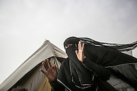 Thursday 16 July, 2015: A displaced woman from the heavy fighting and bombarments in Sa'dah governorate and Haradh bordertown is seen in a temporary settlement in the outskirts of Khamer city in the Amran province of Yemen. (Photo/Narciso Contreras)