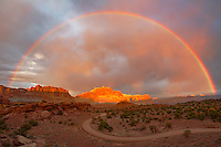 A summer rain storm clears at the top of Panorama Point in Capitol Reef National Park Utah, creating a full rainbow.