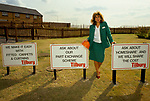 New town development 1990s UK. East London Development. New village of Chafford Hundred Essex being built developed, Marketing person  with advertising signs.