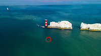 BNPS.co.uk (01202 558833)<br /> Pic: TWT/BNPS<br /> <br /> Pictured: Rob Wylie approaching the finish line near The Needles (circled).<br /> <br /> A daredevil businessman has created a new record by being the first person to circumnavigate the Isle of Wight on an eFoil board.<br /> <br /> Rob Wylie, 51, completed the 55-mile circular route in just 2 hours, 46 minutes and 23 seconds on a Fliteboard, an electric-powered hydrofoil board.<br /> <br /> The board hovers about 3ft above the water and Rob travelled at an average speed of 20mph.