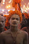 A shaved head indicates this young man is a newly initiated Naga sadhu. Numbers of Naga shadhus are decreasing as less men are willing to undergo the tough lifestyle of the Nagas.