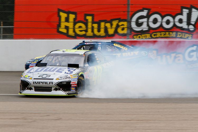 19 June, 2011: Jimmy Johnson brings out the caution as he spins coming out of turn two during the 43rd Annual Heluva Good! Sour Cream Dips 400 at Michigan International Speedway in Brooklyn, Michigan. (Photo by Jeff Speer :: SpeerPhoto.com)