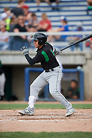 Dayton Dragons third baseman Alejo Lopez (4) follows through on a swing during a game against the Beloit Snappers on July 22, 2018 at Pohlman Field in Beloit, Wisconsin.  Dayton defeated Beloit 2-1.  (Mike Janes/Four Seam Images)