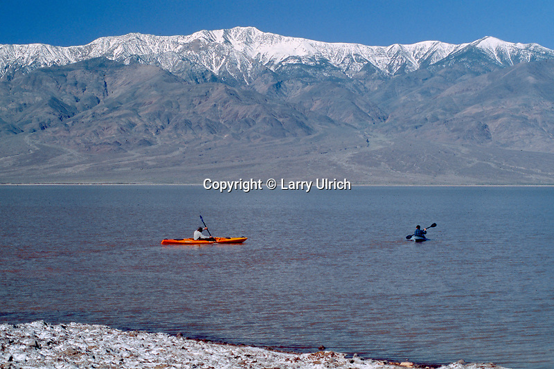 Kayaking after a wet winter at Badwater<br /> Telescope Peak from Death Valley<br /> Death Valley National Park<br /> Mojave Desert,  California