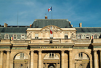 French flags flying outside a government building in Paris, France.