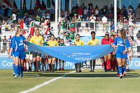 Bradenton, FL - Sunday, June 12, 2018: Referee, banner girls during a U-17 Women's Championship Finals match between USA and Mexico at IMG Academy.  USA defeated Mexico 3-2 to win the championship.