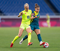TOKYO, JAPAN - JULY 24: Sofia Jakobsson #10 of Sweden fights for the ball with Steph Catley #7 of Australia during a game between Australia and Sweden at Saitama Stadium on July 24, 2021 in Tokyo, Japan.