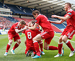 Ryan Christie congratulated on his goal by Johnny Hayes, Ash Taylor and Adam Rooney