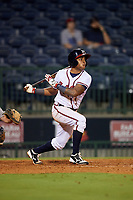 Mississippi Braves shortstop Luis Valenzuela (1) follows through on a swing during a game against the Mobile BayBears on May 7, 2018 at Trustmark park in Pearl, Mississippi.  Mobile defeated Mississippi 5-0.  (Mike Janes/Four Seam Images)