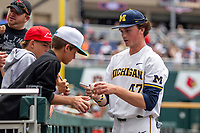 Michigan Wolverines pitcher Tommy Hunter (47) signs autographs for fans prior to Game 11 of the NCAA College World Series against the Texas Tech Red Raiders on June 21, 2019 at TD Ameritrade Park in Omaha, Nebraska. Michigan defeated Texas Tech 15-3 and is headed to the CWS Finals. (Andrew Woolley/Four Seam Images)