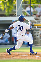 Christian Cano (30) of the Burlington Royals follows through on his swing against the Greeneville Astros at Burlington Athletic Park on June 29, 2014 in Burlington, North Carolina.  The Royals defeated the Astros 11-0. (Brian Westerholt/Four Seam Images)