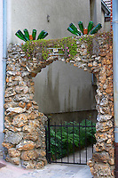 An entrance to a village house decorated with stones and bottles, the village of Hautvillers in Vallee de la Marne, Champagne, Marne, Ardennes, France