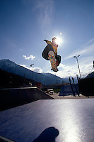 A skateboarder jumps off a ramp.