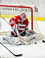6 November 2009: University of Massachusetts Lowell River Hawks' goaltender Nevin Hamilton, a Senior from Ashland, MA, makes an overtime save against the University of Vermont Catamounts at Gutterson Fieldhouse in Burlington, Vermont. The Hockey East rivals battled to a 3-3 tie. Mandatory Credit: Ed Wolfstein Photo