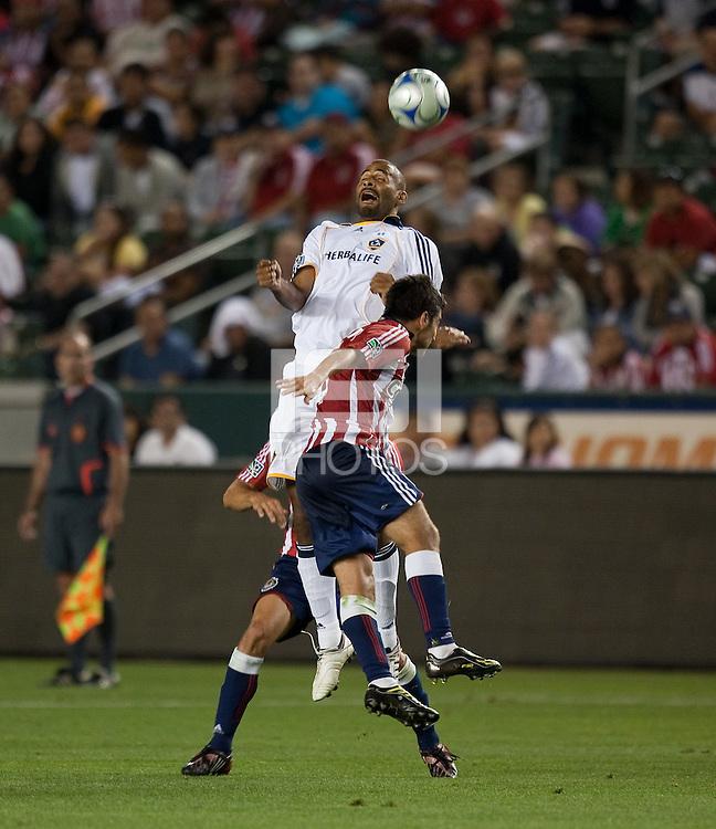 Tony Sanneh heads the ball over Paulo Nagamura. The LA Galaxy defeated Chivas USA 1-0 at Home Depot Center stadium in Carson, California Saturday evening July 11, 2009.