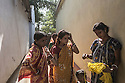 Young girls from the Adivasi tribe seen in the streets chatting. Activities tend to separate boys and girls from a very early age. Men tend to get drunk often and women easily become a target.