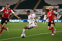 Pictured: Jefferson Montero of Swansea (C) against Kirk Broadfoot (L) and Ben Pringle of Rotherhamy (R). Tuesday 26 August 2014<br />