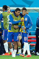 Oscar of Brazil celebrates at the end of the match with Paulinho