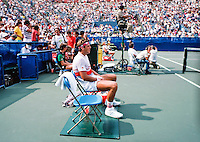 1985, New York, USA, August 29, Tennis, US Open, Huub van Boeckel (NED)  during changeover in his match against Boris Becker (GER) in the background<br /> Photo: Henk Koster
