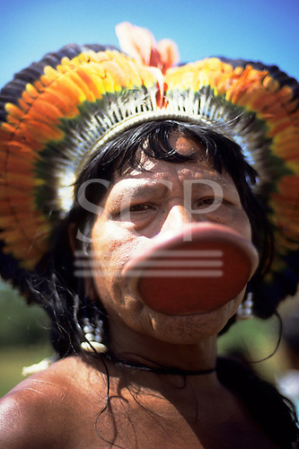 Amazon, Brazil. Chief Raoni Methuktire of the Megranoti (Kayapo Nation) with botoque lip plate and feather cocar headdress.