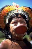 Amazon, Brazil. Chief Raoni Methuktire of the Megranoti (Kayapo Nation) with botoque lip plate and feather cocar headdress.