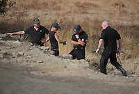 Pictured: Detective Inspector Jon Cousins (R) joins forensic archaeologists at the second site in Kos, Greece. Wednesday 12 October 2016<br />Re: Police teams led by South Yorkshire Police are searching for missing toddler Ben Needham on the Greek island of Kos.<br />Ben, from Sheffield, was 21 months old when he disappeared on 24 July 1991 during a family holiday.<br />Digging has begun at a new site after a fresh line of inquiry suggested he could have been crushed by a digger.