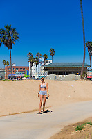Girl on a skateboard, Venice beach, Los Angeles, California