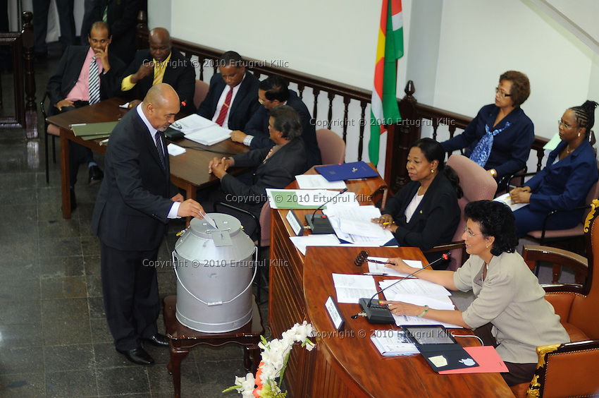 Desi Bouterse (Desiré Delano Bouterse) drops his vote during presidential elections at De Nationale Assemblée (DNA) / The National Assemble of Suriname....Desi Bouterse (Desiré Delano Bouterse) chosen as new president of Suriname by De Nationale Assemblée (DNA) / The National Assemble of Suriname. He took 36 votes of 51 as leader of the Mega Combination. ....Robert_Ameerali the head of KKF (Kamer van Koophandel en Fabrieken) / Chamber of Commerce and Industry also selected as Vice President.....Desi Bouterse (Desiré Delano Bouterse) will sworn at 3 August 2010