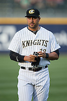 Matt Tuiasosopo (18) of the Charlotte Knights warms up in the outfield prior to the game against the Norfolk Tides at BB&T BallPark on April 9, 2015 in Charlotte, North Carolina.  The Knights defeated the Tides 6-3.   (Brian Westerholt/Four Seam Images)