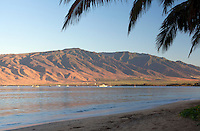 Beautiful morning light warms the West Maui Mountains at Kihei, Maui.