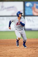 Dionis Rodriguez (11) of the Kingsport Mets hustles towards third base against the Danville Braves at American Legion Post 325 Field on July 9, 2016 in Danville, Virginia.  The Mets defeated the Braves 10-8.  (Brian Westerholt/Four Seam Images)