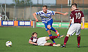 Morton's Robbie Crawford gets past Stenny's Kieran Millar and Sean Dickson (10).