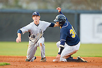 Georgia Southern Eagles shortstop Ben Morgan (18) applies the tag to Cambric Moye (30) of the UNCG Spartans as he tries to steal second base at UNCG Baseball Stadium on March 29, 2013 in Greensboro, North Carolina.  The Spartans defeated the Eagles 5-4.  (Brian Westerholt/Four Seam Images)