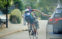 in a very hot stage the job of the water carrier/domestique can not be overstated<br /> Jérome Pinaut (FRA/IAM) on duty here<br /> <br /> 2014 Tour de France<br /> stage 12: Bourg-en-Bresse - Saint-Etiènne (185km)